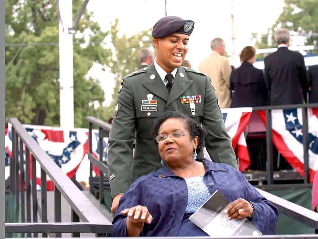 U.S. soldier pushing wheelchair of Melba Pattillo Beals - I will not fear