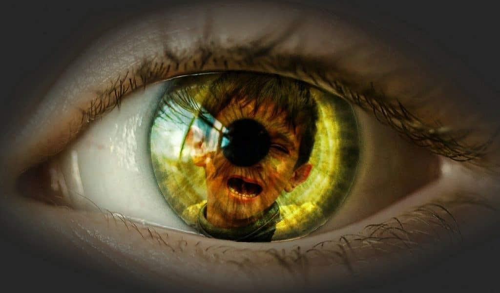 Eye reflecting a crying child