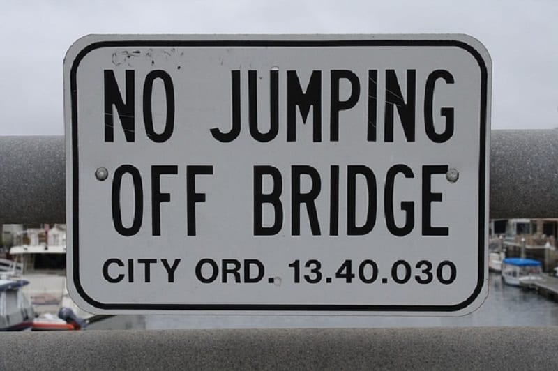 No jumping off bridge sign - About suicide