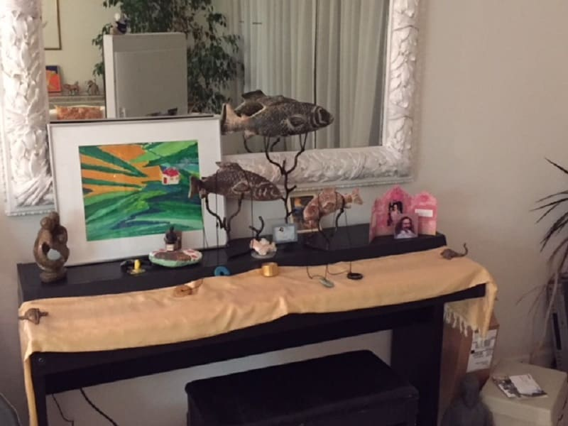 Desk in home with painting and small Meher Baba photo - Poems by Max Reif