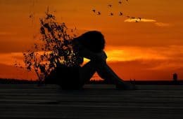 Silhouette of woman at sunset, exploding with stress - Fast-paced and frenetic