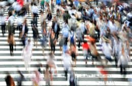 Blurry image of pedestrians moving across extremely busy crosswalk - Breaking up with busy