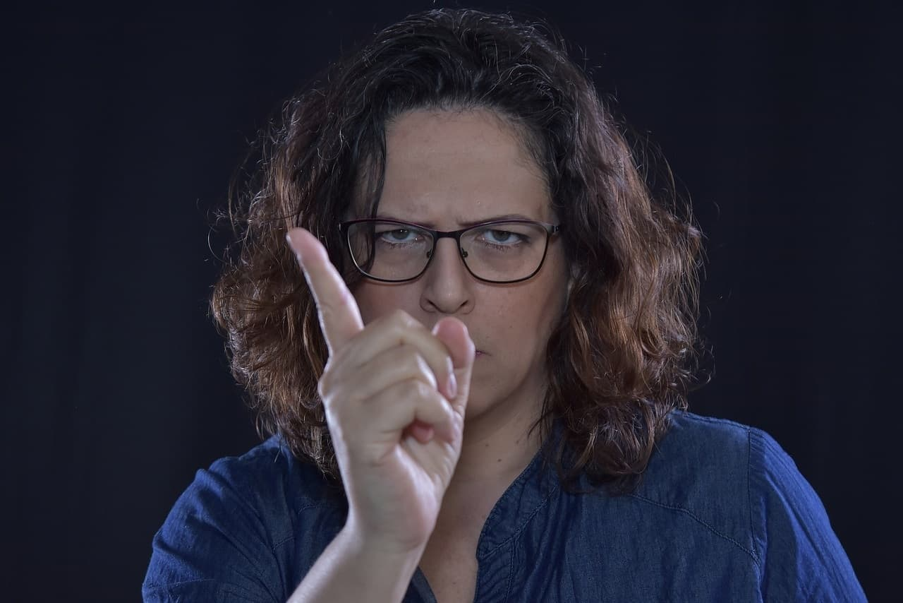 Angry middle-aged woman pointing finger - There's no such thing as naughty