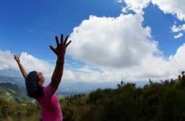woman with hands in the air enjoying the view