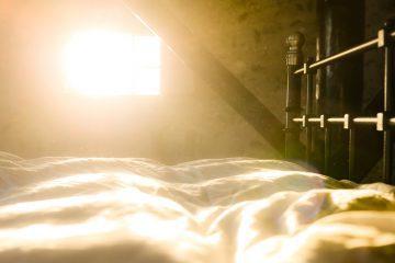 Sun shining through window onto bed - Early mornings