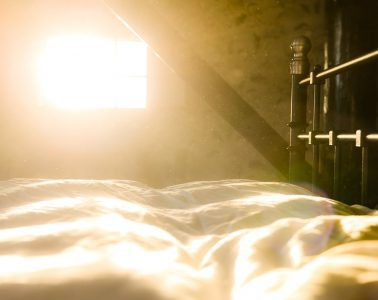Sun shining through window onto bed - Early mornings