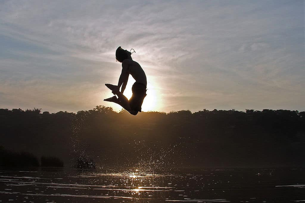 Person jumping into air above water - When food is comfort