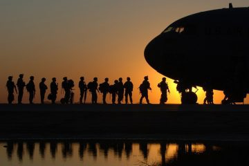 Soldiers boarding a plane for Iraq