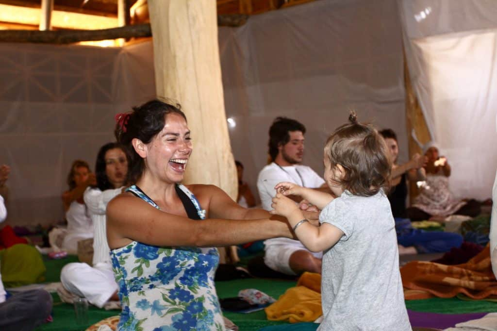 Woman and child practicing Kundalini Yoga, along with others - A course in self-mastery