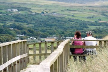 Married couple sitting on bench overlooking countryside - The 5 love languages