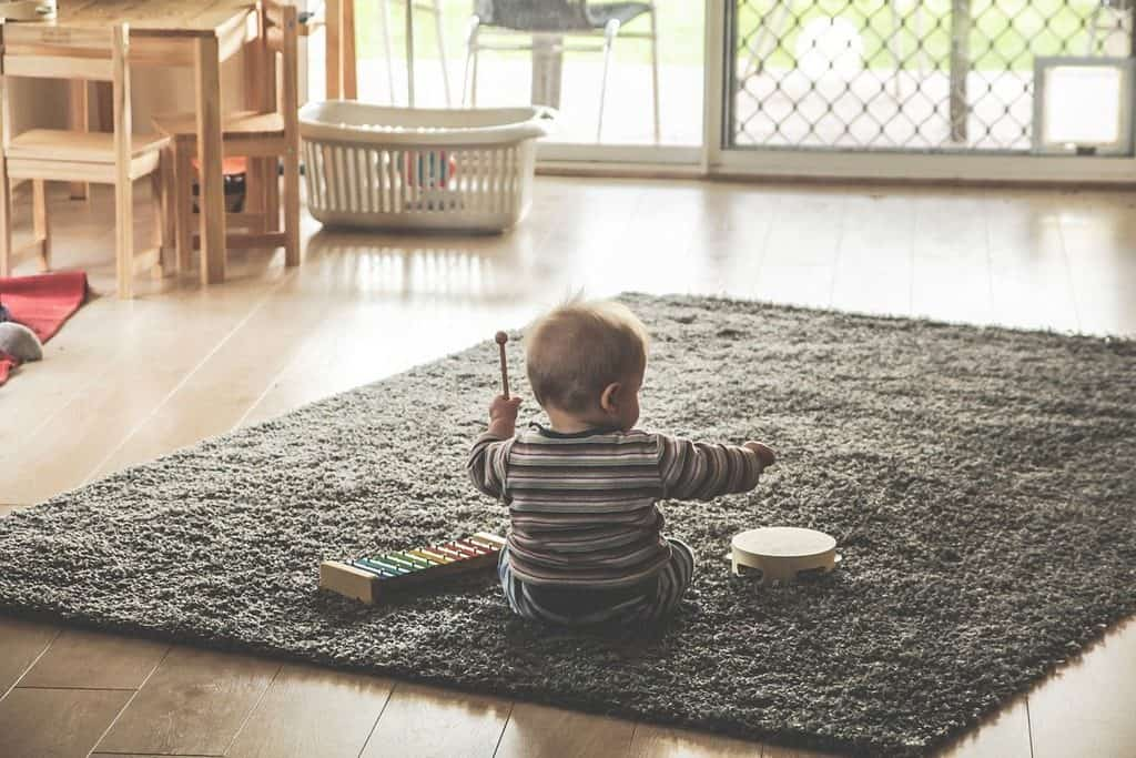 baby playing with toy instruments