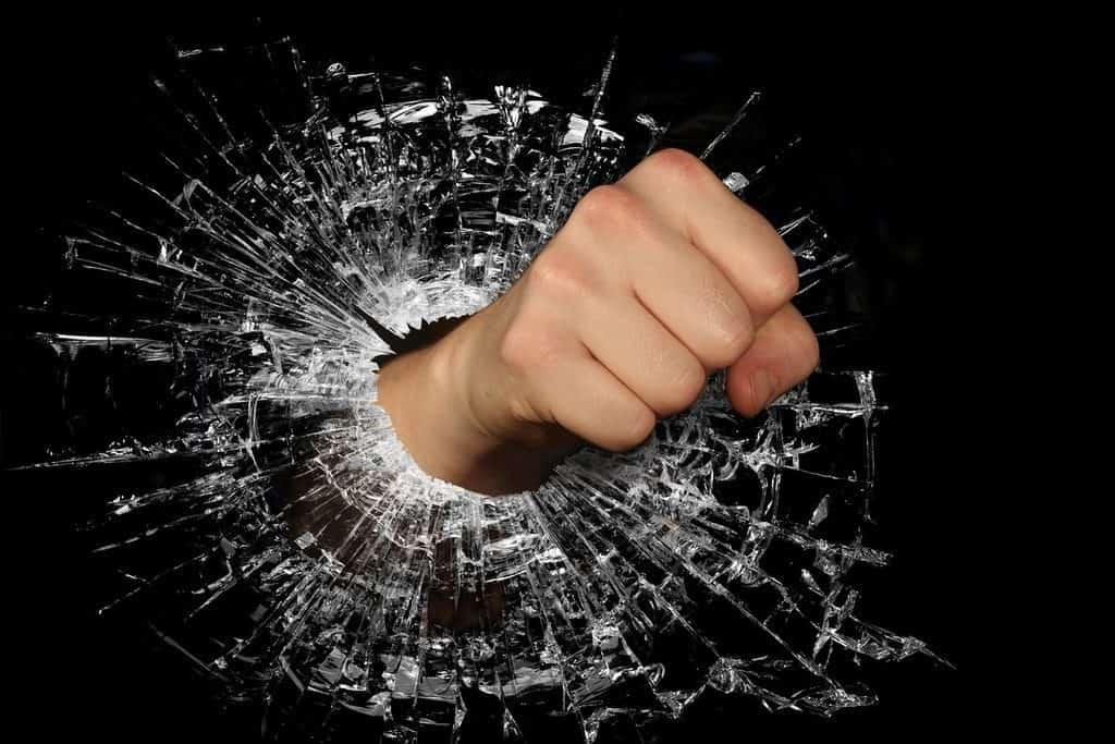 fist going through glass