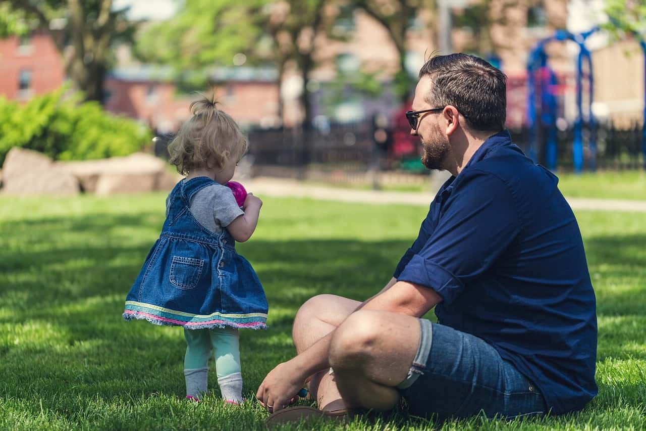 Female toddler and father in park - Life lessons from a broken heart