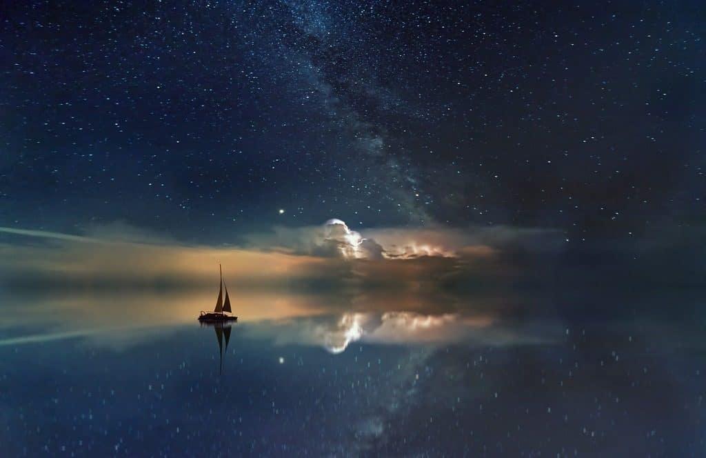 boat night sky river