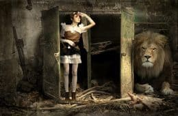 woman at door next to a lion