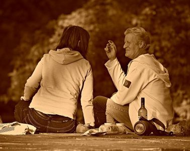 Man and woman in park with alcohol