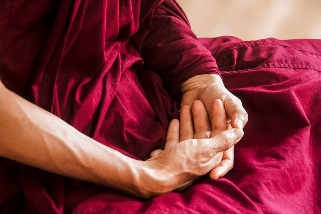 monk's hands in meditation