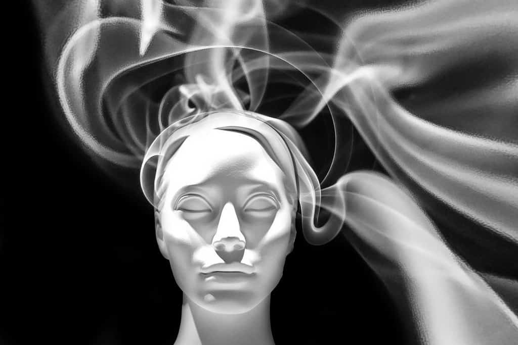 Woman with mist around head