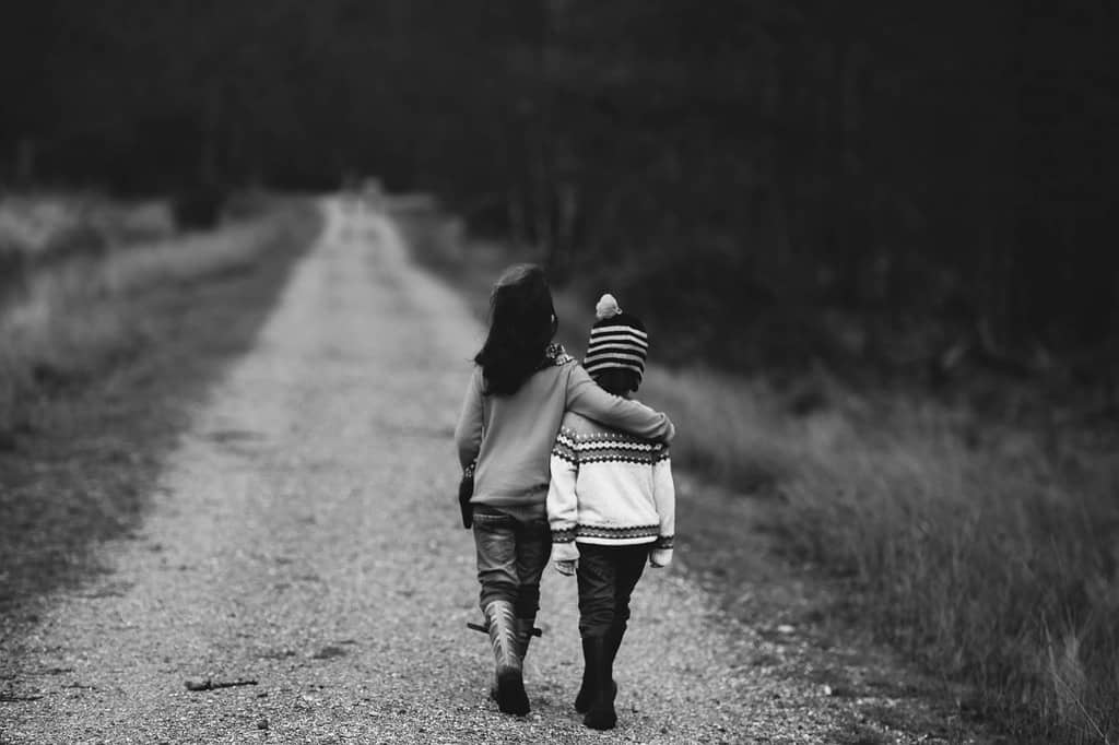 children walking with arms around each other