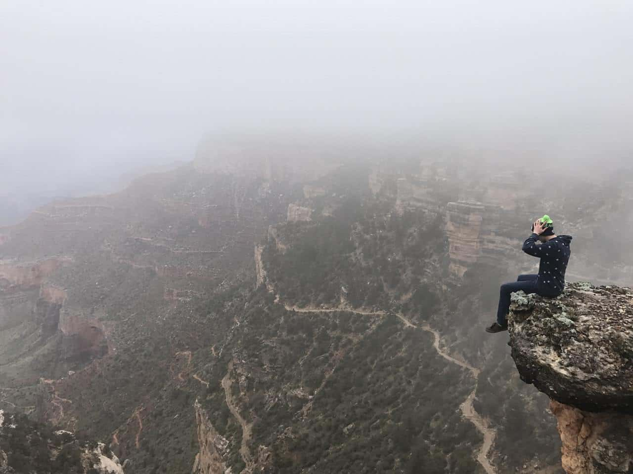 Man sitting on edge of cliff - Blessed