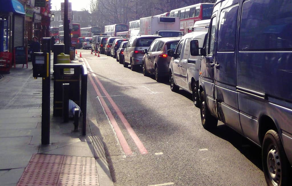 Traffic jam on London, England street - Coffee drinkers and taxi drivers