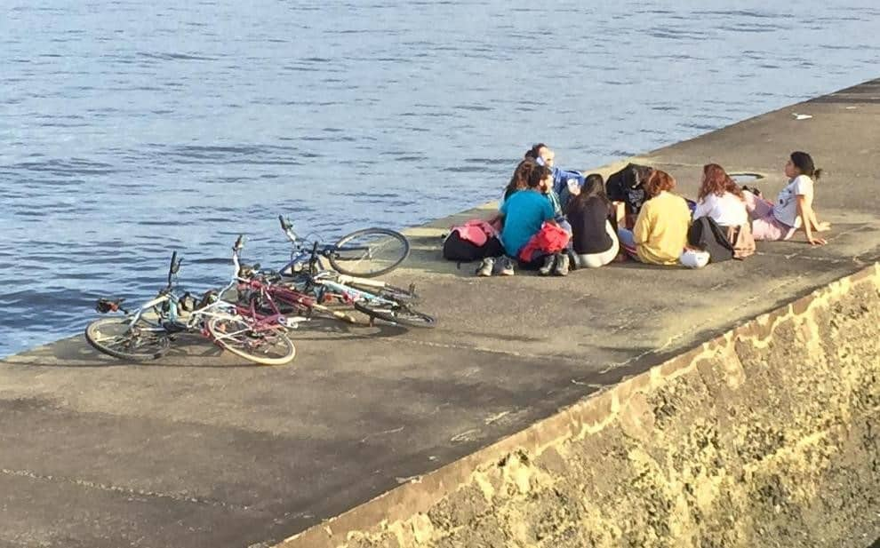 Kids with bikes on a pier - A day in Montevideo