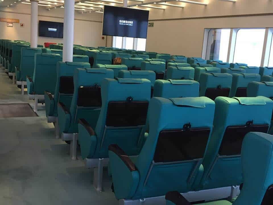 Seats and tv screens on Buquebus ferry - A day in Montevideo