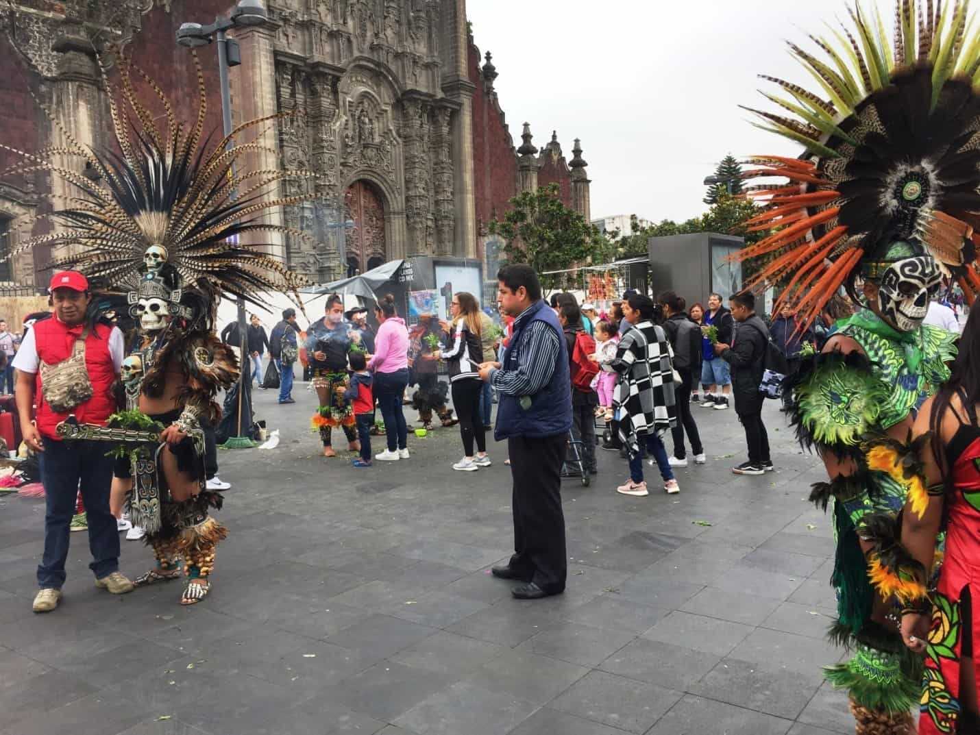 People in Aztec headdresses and death-heads - A very full first day in Mexico City