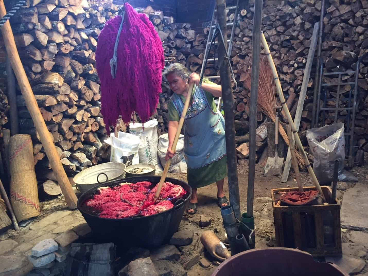 Teotitlan shop owner dyes yarn with natural red dye - Wonders of Oaxaca
