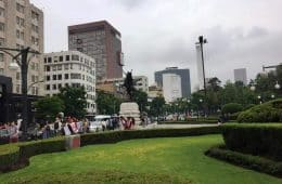 upbeat crowd strolling along Avenida Benito Juarez in Mexico City - A very full first day in Mexico City