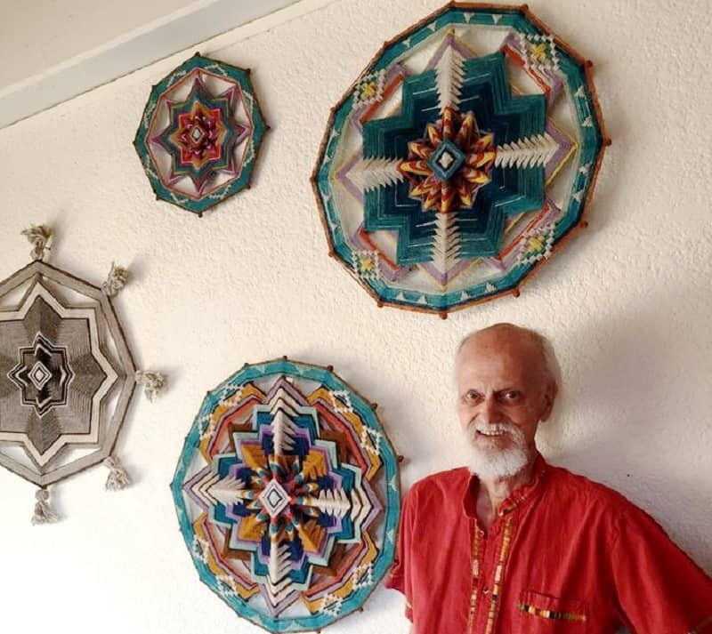 Jay Mohler with some of his Ojos de Dios woven mandalas - Wonders of Oaxaca