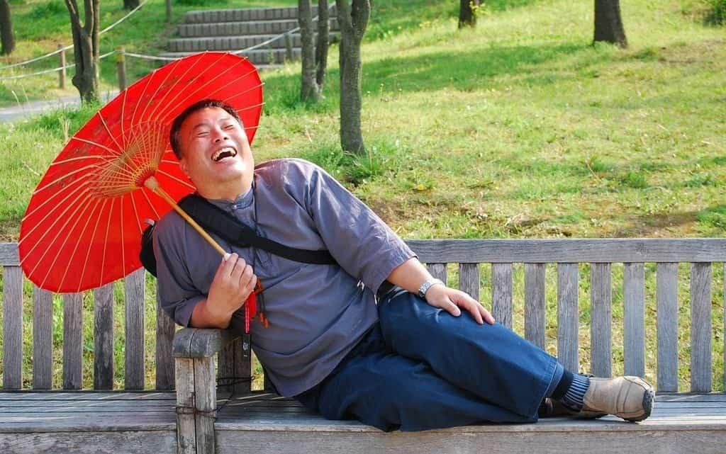 laughing man on bench