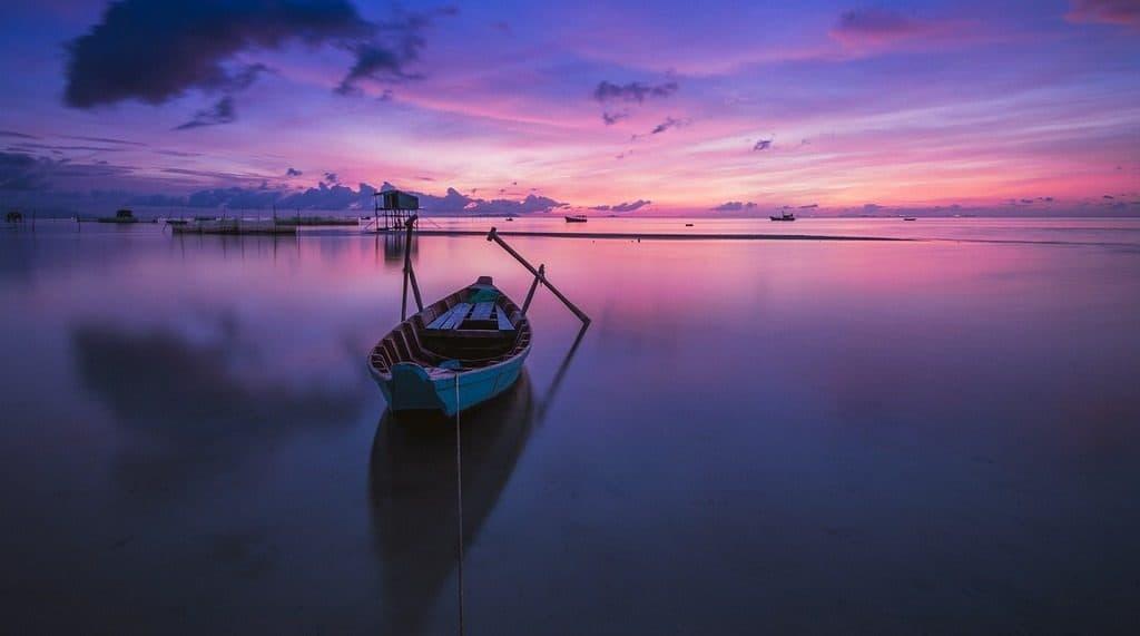 boat on lake at sunrise