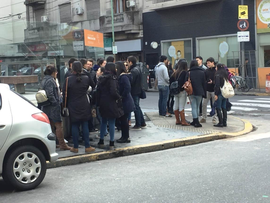 People talking on Buenos Aires street corner - An American in Argentina