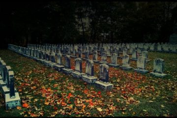 Tombstones in a cemetery in the fall - Poems by George Payne