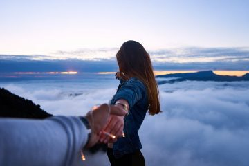 Two people holding hands on top of mountain - Poetry by Liezl Duff