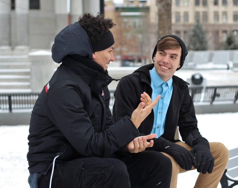 Two men sitting and talking peacefully in winter - Say What You Mean