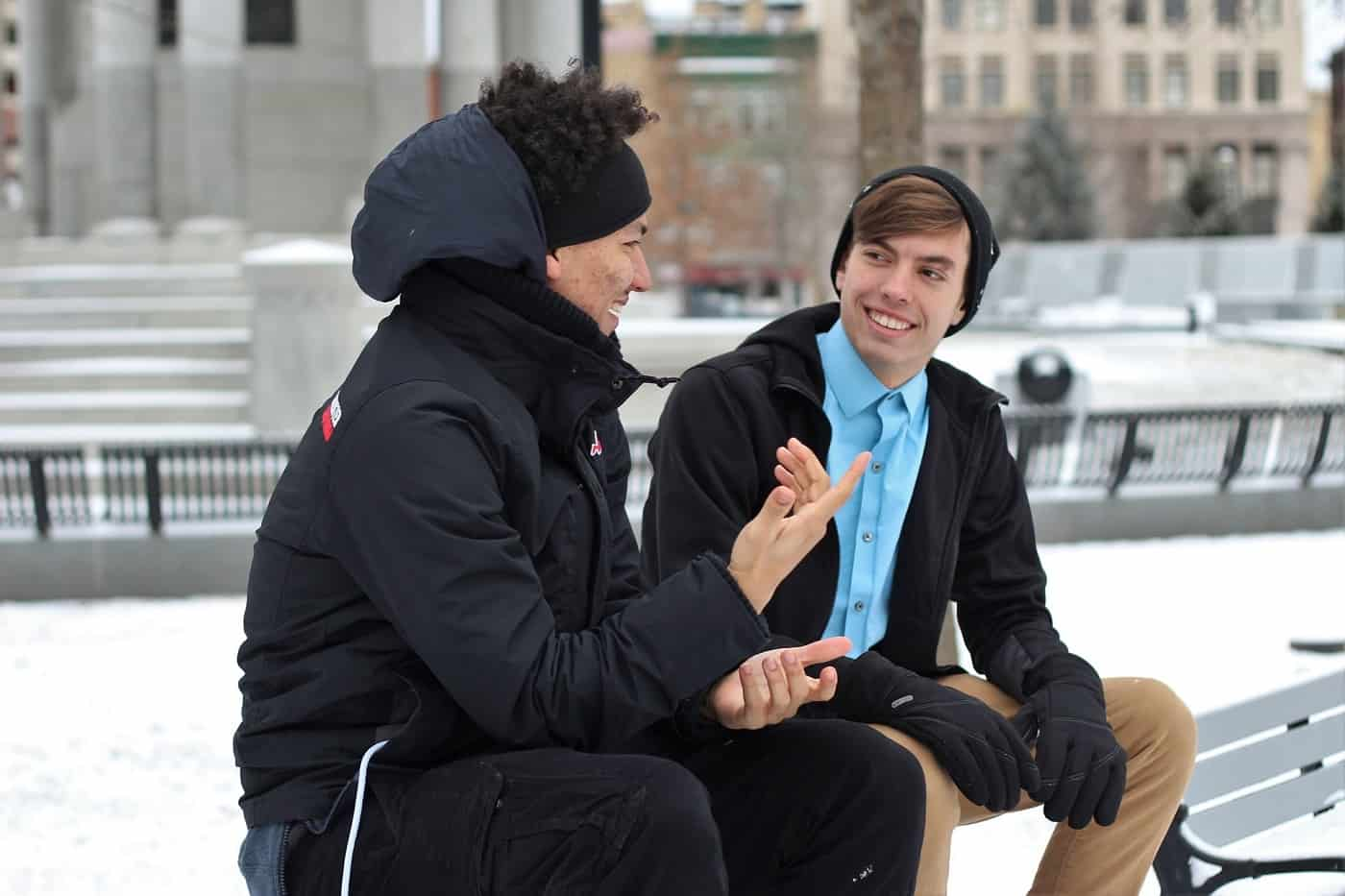 Two men talking peacefully on bench in winter - Say What You Mean