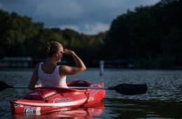 Woman paddling in sea kayak - Addiction treatment