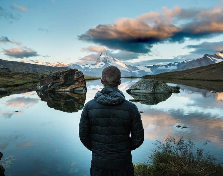 Solitary man looking out at lake - Poems by Mike Larcombe