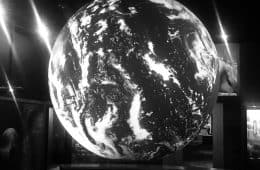 Black and white Earth in front of TV - Poems by George Payne