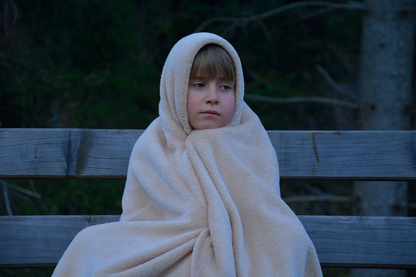 Young child wrapped up in blanket - Cut the cords