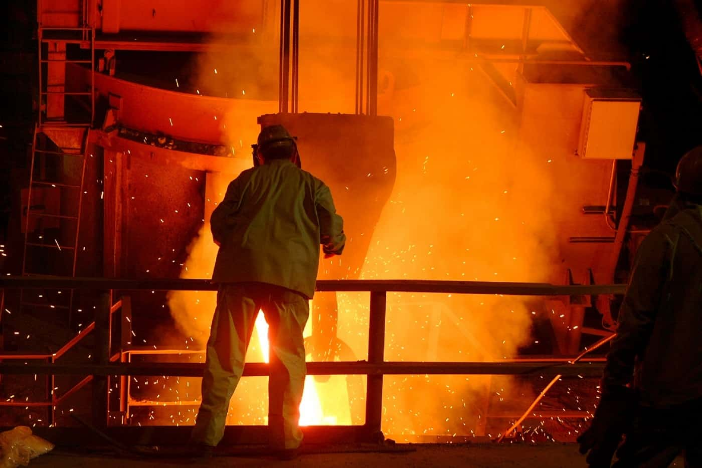 Two people working at steel mill - Family myths