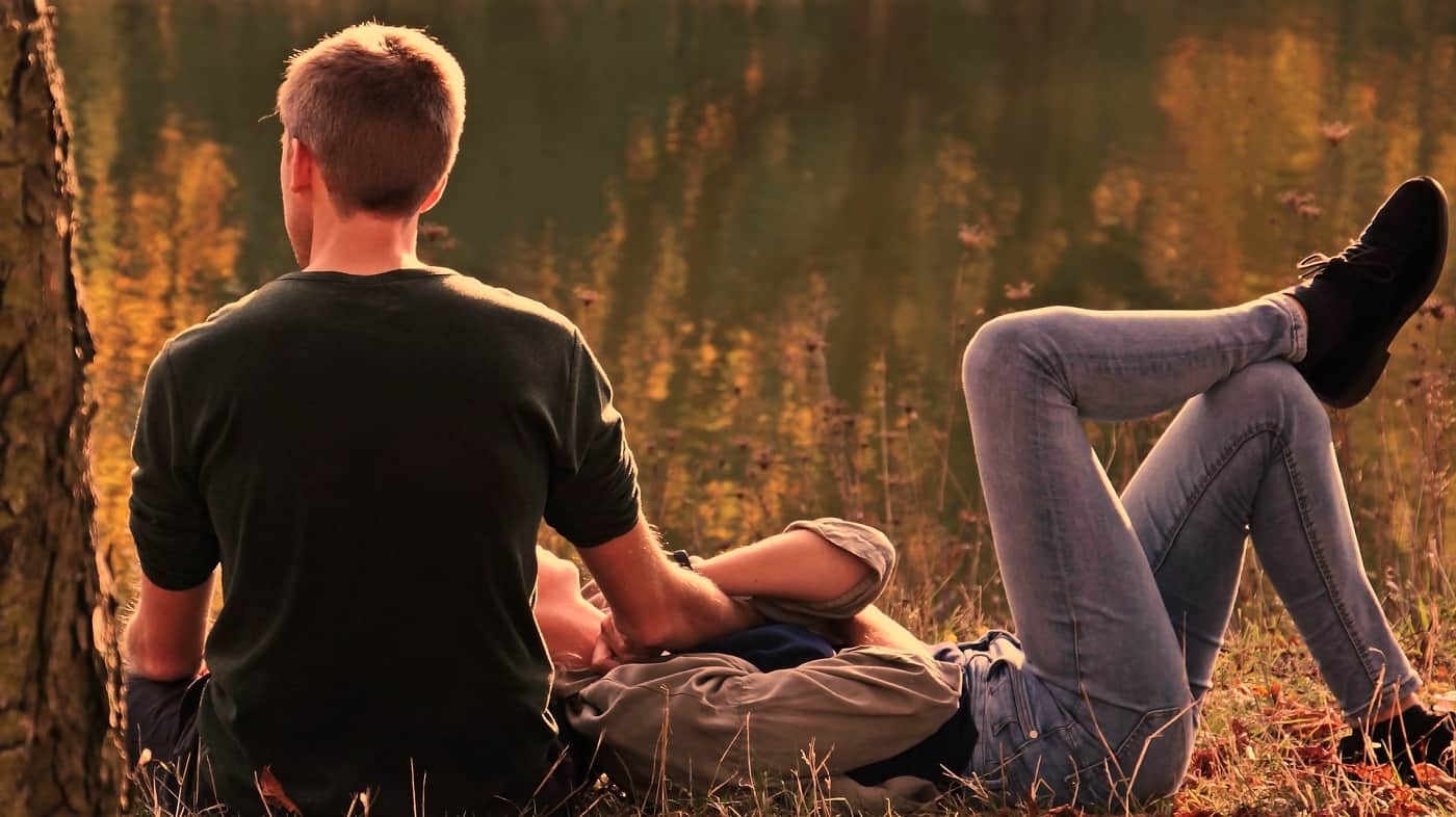 Couple sitting in grass together - Happily ever after