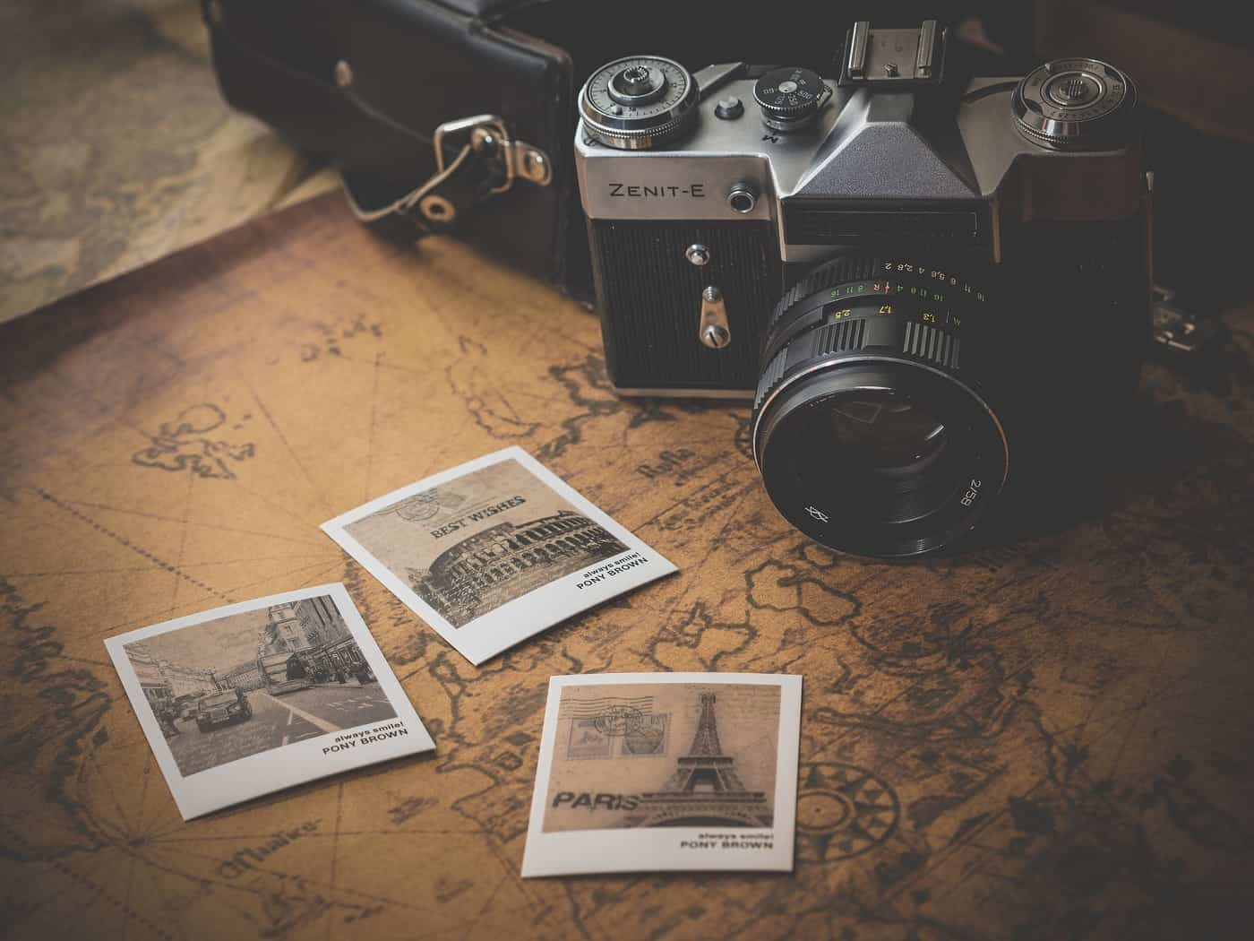 Old camera, map and snapshot photos - Cost-effective travel