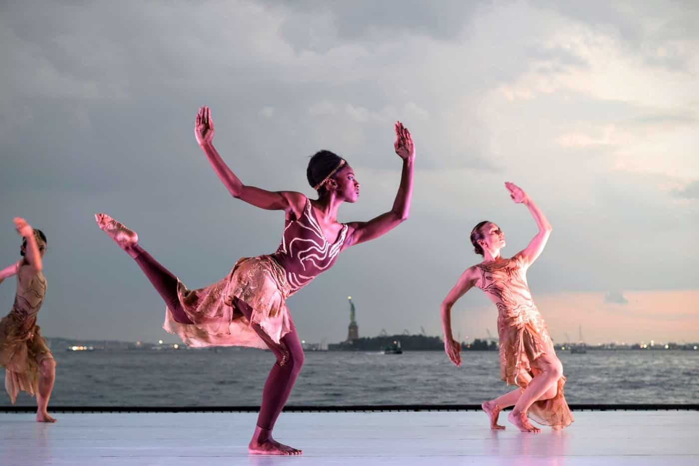 Three women dancing on beach - A guide to Koh Phangan, Thailand