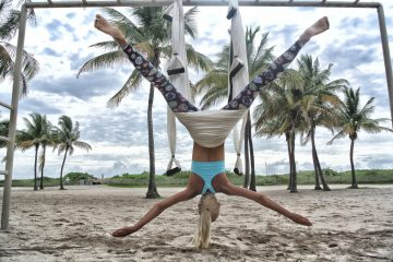 Woman doing aerial yoga on beach - A guide to Koh Phangan, Thailand
