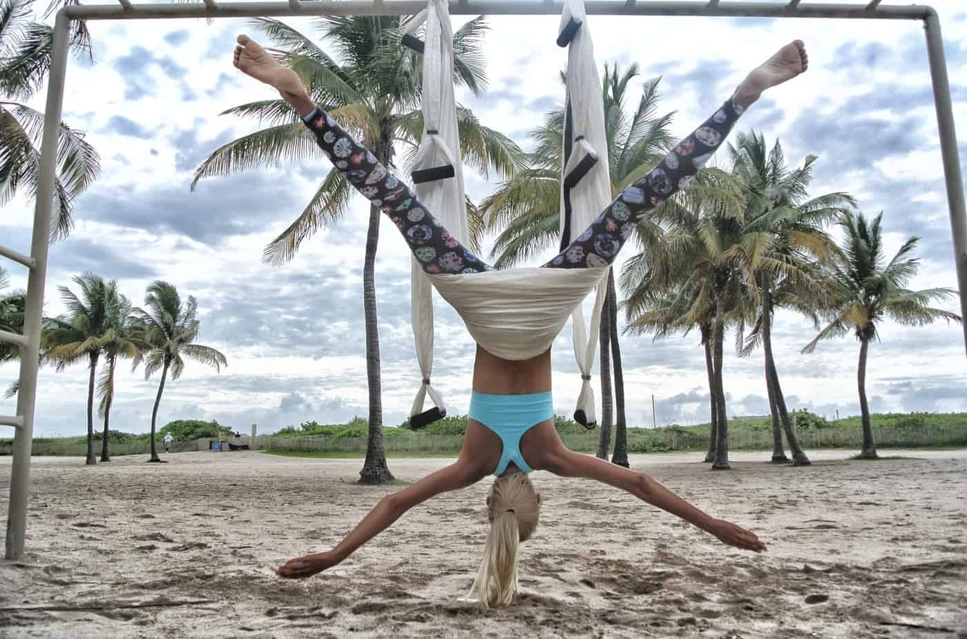 Woman doing aerial yoga on beach - A guide to Koh Phangan, Thailand