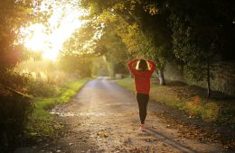 Girl walking on path in sun - Your fittest future self