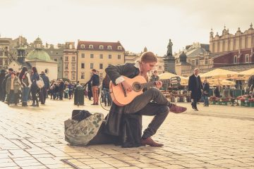 Musician playing guitar in street